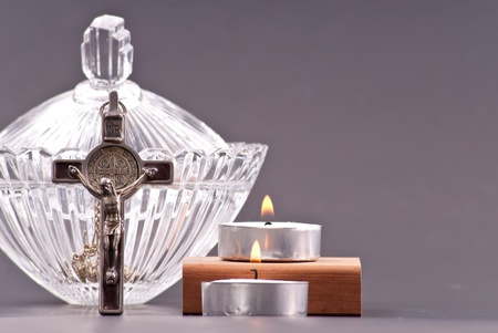 Crucifix Pendant with Lit Candles and Holy Water photo