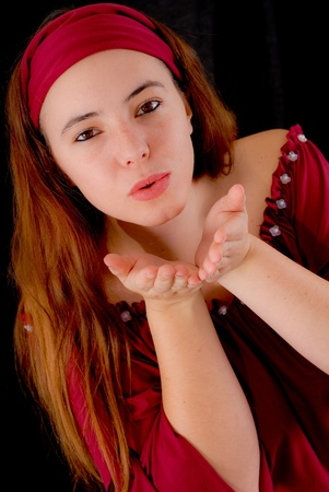 Portrait of a Gypsy Blowing a Kiss Stock Photo - 9000466