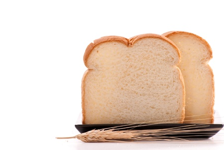 White Bread on Plate with Grain Stalk photo