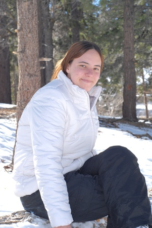 Young Caucasian Female Smiling in Snow Setting Stock Photo - 9063613
