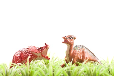 herbivore: Two Herbivore Toy Dinosaurs in Grass
