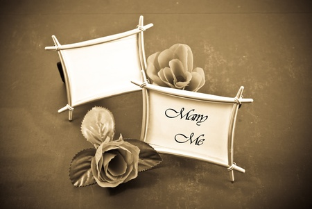 Two Frames and Roses with One Frame Saying Marry Me photo