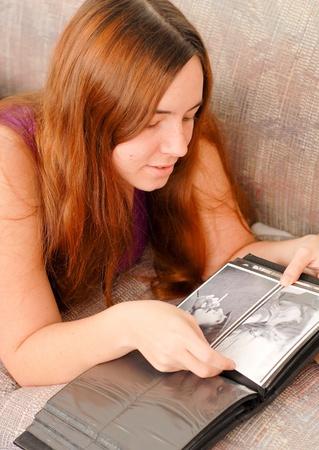 Caucasian Female Looking Through Her Photo Album photo