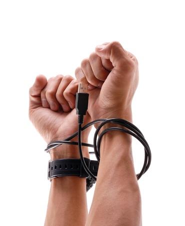 esclavo: Esclavo de tecnolog�a Foto de archivo
