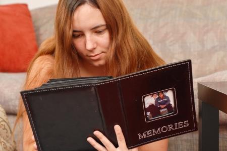 album photo: Going Through Her Photo Album Stock Photo