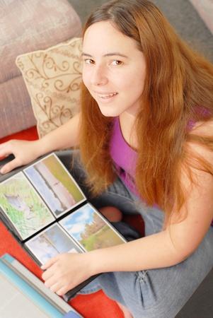 photo album: Happy Smiling Girl with Her Photo Album