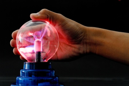 electric current: Hand Playing with a Plasma Tesla Ball