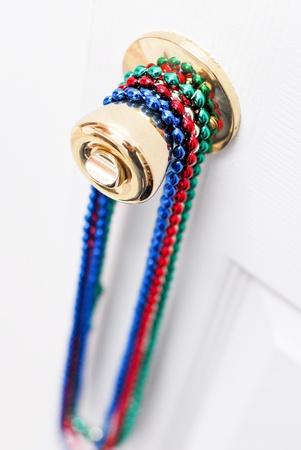 Mardi Gras Bead Necklaces on Door Knob photo