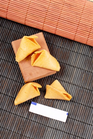 Cracked Fortune Cookies with Blank Fortune Paper photo