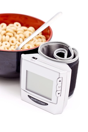diastolic: Blood Pressure Monitor with Bowl of Healthy Cereal