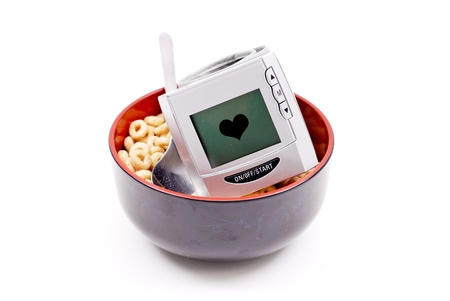 self testing: Blood Pressure Wrist Monitor in Bowl of Healthy Cereal