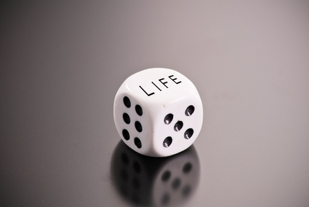 Rolling The Dice of Life Stock Photo - 9404386