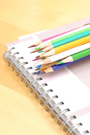 Colored Pencils on Sketch Book Stock Photo - 9412355