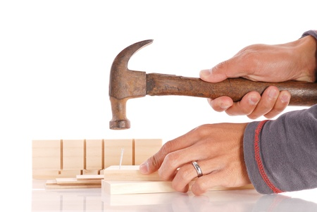 Nailing Two Parts Together Stock Photo - 9420352