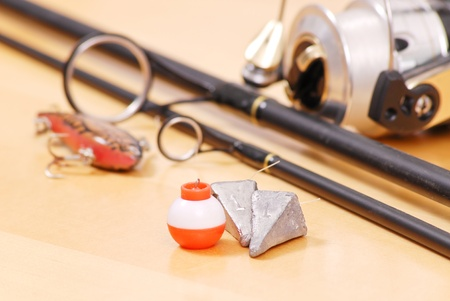 floater: Fishing Weights and Floater Next to Black Fishing Rod