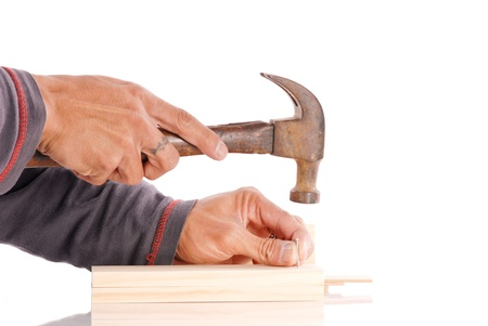 Hands Getting Ready to Hammer in a Nail Stock Photo - 9468849