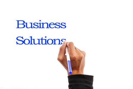person writing: Business Solutions Stock Photo