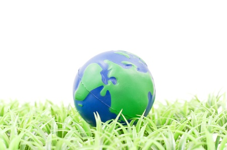 Planet Shaped Ball on Grass photo