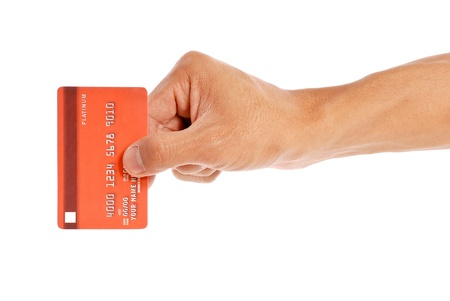 business card in hand: Swiping Your Credit Card