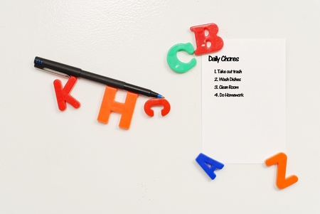 forgetfulness: Daily Chores List on Fridge Door Stock Photo