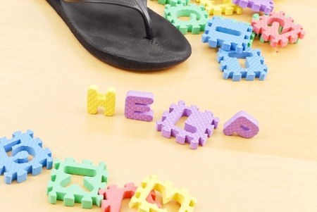 Letters Spelling the Word Help on Floor with Mommys Slipper  Stock Photo - 9835471