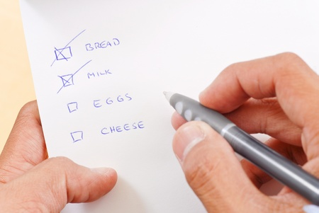 shopping list: Shopping Check List with Bread and Milk Crossed Off Stock Photo