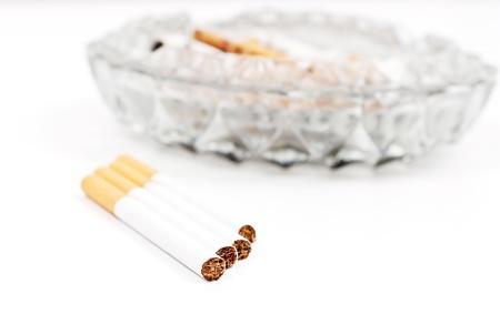 Cigarettes Near Glass Ashtray in Shallow DOF Foto de archivo