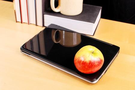 Apple on Laptop Computer photo