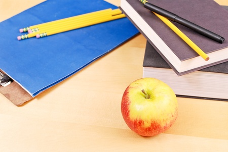 Apple with School Supplies photo