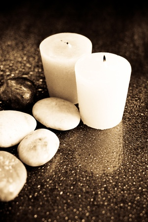 Wet Candles and Stones Stock Photo - 10129030