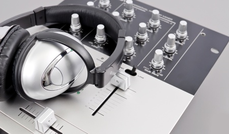 music production: Studio Mixer and Headphones Stock Photo