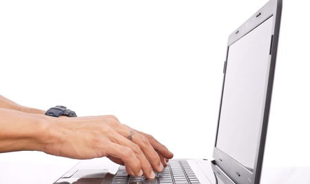 Hands Typing on a Laptop Computer photo