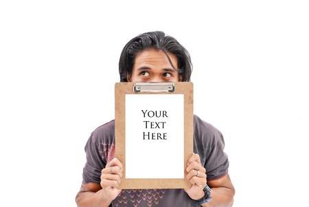 filipino adult: Hand Hiding Behind a Clipboard Stock Photo
