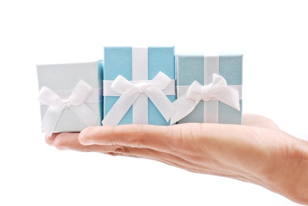 Hand holding three Gifts photo