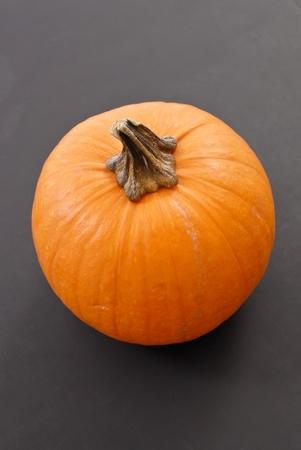 Pumpkin on Gray Surface photo