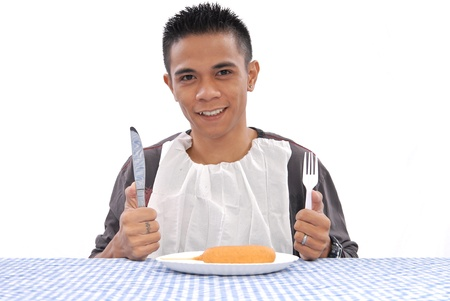 chomp: Man Getting Ready to Eat a Corn Dog