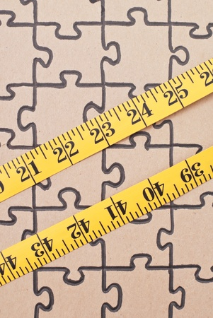 weight loss plan: Tape Measure on Completed Puzzle