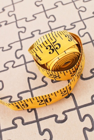 inches: Tape Measure on Puzzle Stock Photo