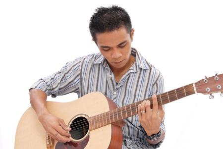 playing folk: Guy Playing Guitar