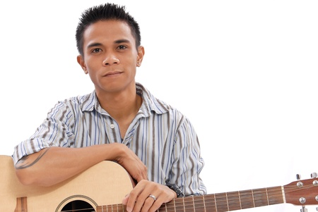 Guy Holding an Acoustic Guitar Stock Photo - 10987529