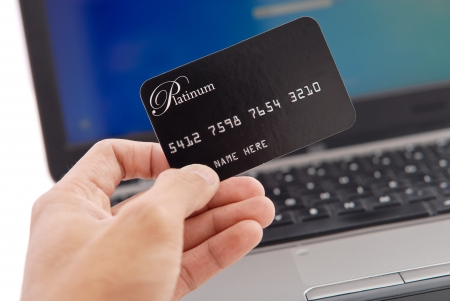 utility payments: Hand with Credit Card Stock Photo