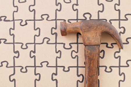 Hammer on Puzzle Stock Photo - 11058410