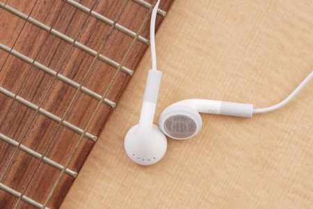 Pair of Earphones on Guitar photo