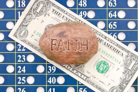 Faith on a Dollar against Lottery Number Sheet photo