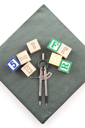 Compass with Blocks on Graduation Hat Stock Photo - 11106069