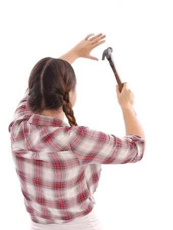 Female worker Using a Hammer photo