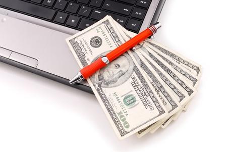 preorder: Pen on Hundred Dollar Bills Stock Photo