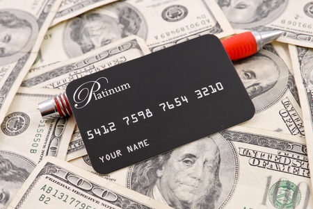 money pile: Credit Card with Pen on Pile of Money Stock Photo