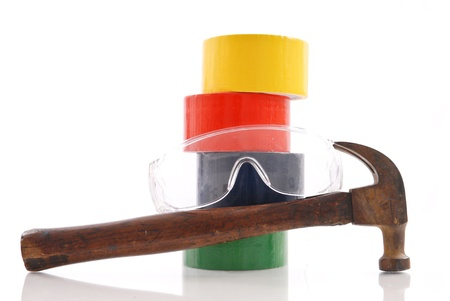 duct tape: Hammer and Safety Glasses with Duct Tape in Background Stock Photo