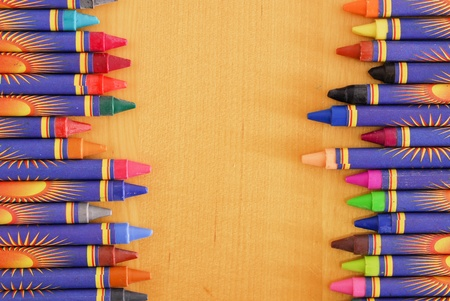 staggered: Two Rows of Staggered Crayons on Table Stock Photo